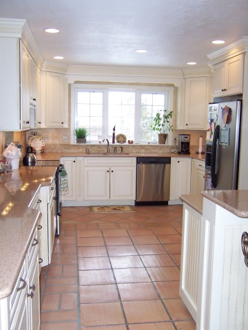 Inexpensive saltillo tile with painted and glazed cabinets.